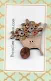 Wheel Barrow and Pastel Flowers Button by Theodora Cleave
